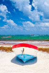 Fototapete - Colorful fishing boats at the beach in Tulum in Mexico