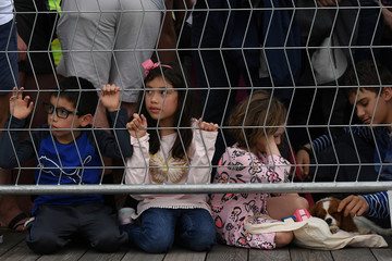 Children watch a 'Running of the Chihuahuas' dog race as part of Cinco de Mayo celebrations in Washington