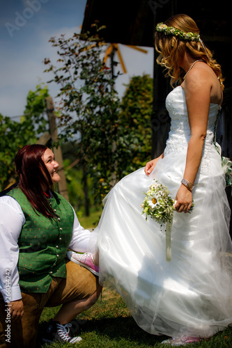 Young pretty marriage couple smiling at each other bending
