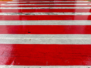 Red and white zebra crossing