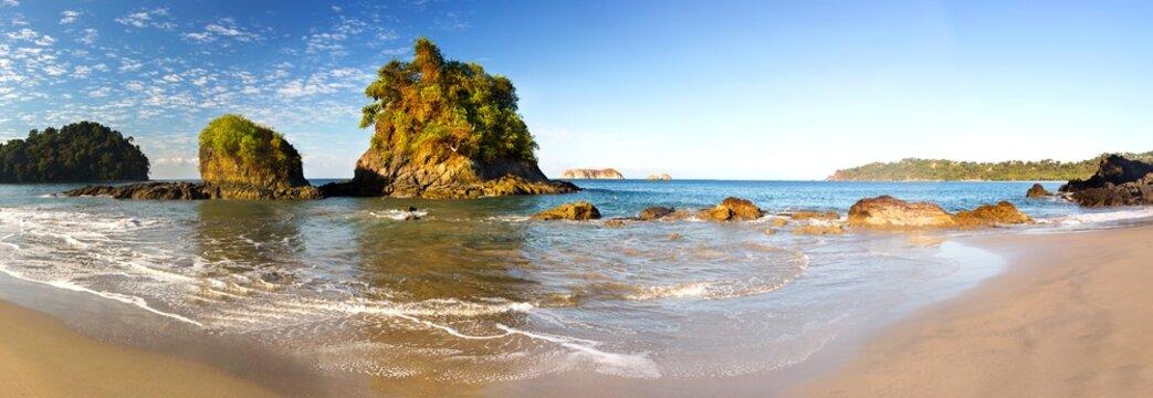 Wide Panoramic Landscape of Pacific Ocean Coastline and Small Islands on Manuel Antonio National Park Playa Espadilla Beach in Costa Rica