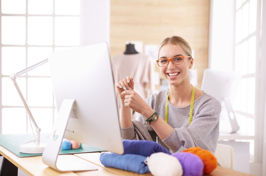 Fashion designer using tablet computer in the studio