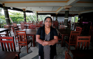 Samanmali Colonne, 51, poses for a photograph inside the Warahena Beach hotel in Bentota