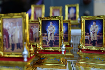 Portraits of Thailand's newly crowned King Maha Vajiralongkorn are picture before a coronation procession in Bangkok