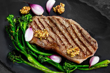 Porterhouse Steak Grilled with Broccolini Pickled shallots and Mustard