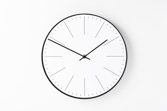 Round wall clock on white background. Minimal creativity concept