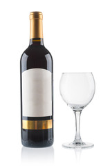 Red wine bottle with empty glass on white background
