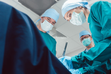 Team of surgeons in operation room during surgery