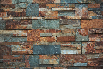Urban stone wall texture background. teal and orange colors.