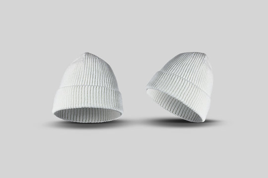 Blank white knitted beanie Mock up, isolated on soft gray background.3D rendering. Empty casual headgear mockup.