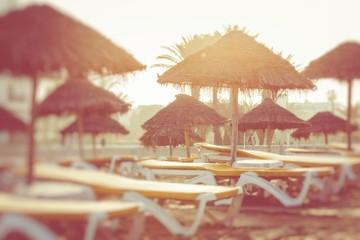 Beach umbrellas on the the beautiful beach in Morocco. Selective focus.