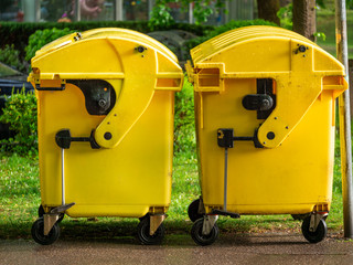 Image of Yellow waste Containers, Recycling bin for special Rubbish, during hail and rainy weather
