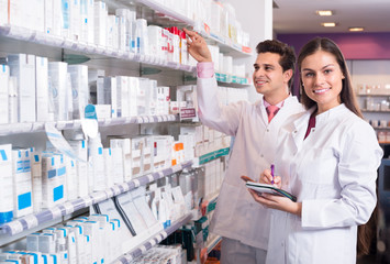 pharmacists posing in drugstore