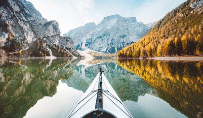 Kayak on alpine lake in fall Wall mural