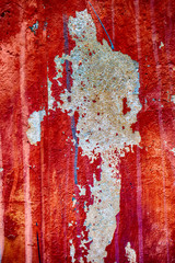 Old cracked rusty peeled colorful paint background texture close-up