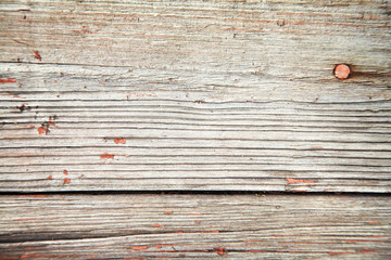 rustic weathered planks with knots and nail