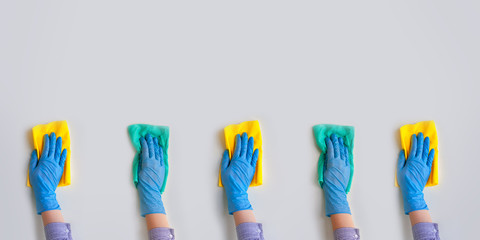 Commercial cleaning company. Employee hands in blue rubber protective glove. General or regular...