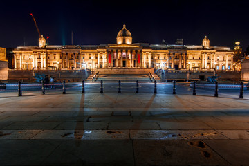 Facade of the National Gallery and the Trafalgar Square in London (England) by Night