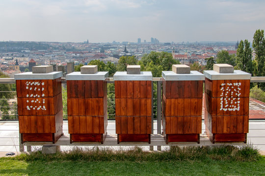 The row of apiary on the roof of a high-rise house in the city, Prague, Czech Republic.