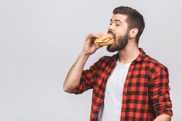 guy dieting by smelling fast food eating celery
