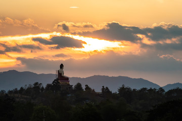 great Buddha statue on the hilltop in the evening, Myawaddy, Myanmar