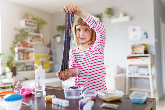 Little girl making homemade slime toy