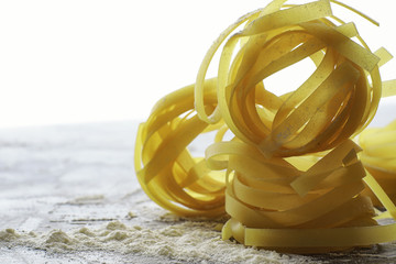 Pasta uncooked on the table. Noodles in the form of nests.