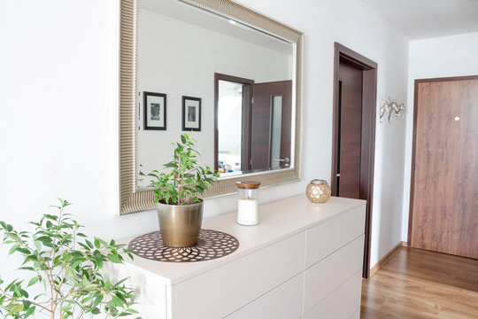 entry hall with white contemporary drawer and mirror