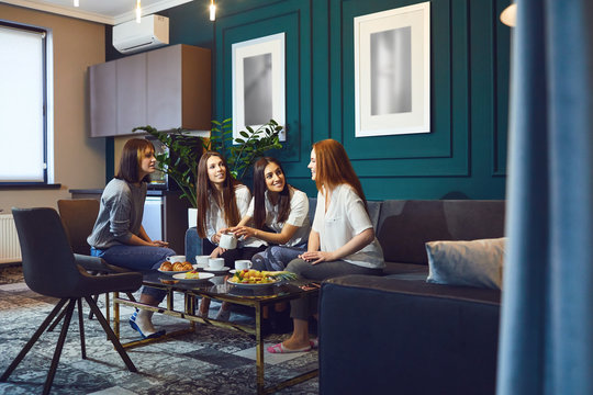 Young women having tea party at home