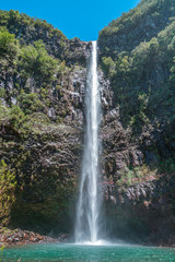 Waterfall in Madeira in a summer sunny day with clear blue sky