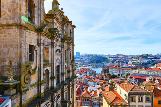 Stunning panoramic aerial view of traditional historic buildings in Porto. Vintage houses with red tile roofs. Famous touristic place and travel destination in  Portugal