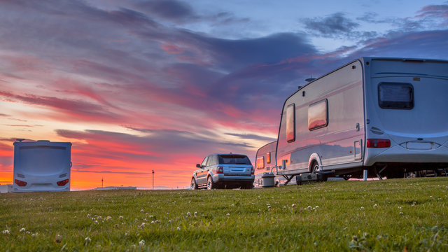 Camping caravans and cars  sunset