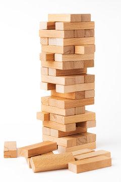 Close up blocks wood game jenga isolated on white background.