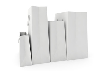 white paper bags on white background