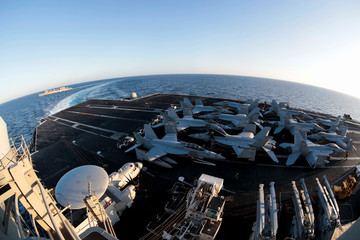 The Nimitz-class aircraft carrier USS Abraham Lincoln breaks away from the fast combat support ship USNS Arctic after an underway replenishment-at-sea in the Mediterranean Sea