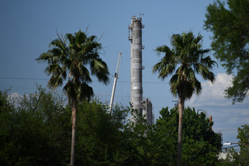 A smoke stack at the Valero refinery by the Houston Ship Channel is seen in Houston