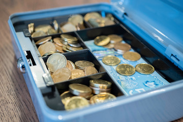 Cash box with coins and notes to keep Petty Cash secure