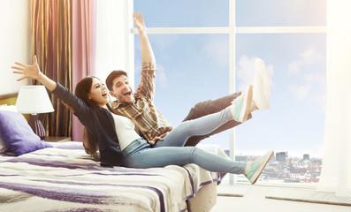Happy Couple Arrived To Hotel Room On Honeymoon