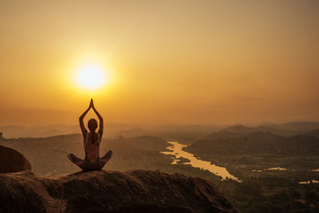 Yoga in Hampi temple copyspase at sunset.travel vacation copy spase lady with stylish jumpsuit Wall mural