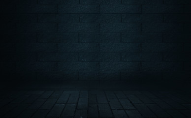 Background of empty dark street. Old brick wall, concrete floor. A spotlight at night illuminates an empty old wall. Smoke, fog
