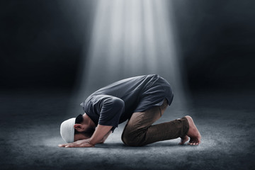 Religious asian muslim man praying