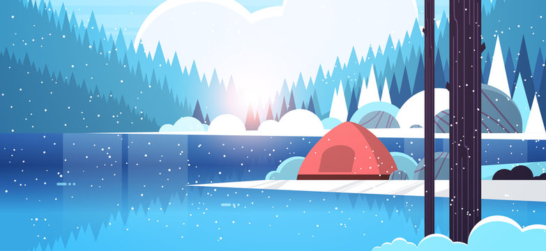 tent camping area in forest campsite near river winter camp travel vacation concept snowfall sunrise landscape nature background with water mountains and hills flat horizontal