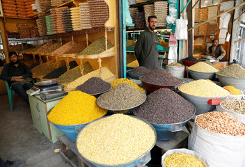 Dried fruit vendors wait for customers on the first day of the holy month of Ramadan in Kabul, Afghanistan