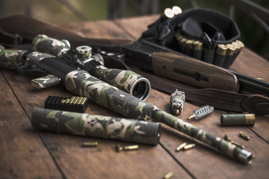 Small caliber 22 long rifle and double-barreled hunting rifle