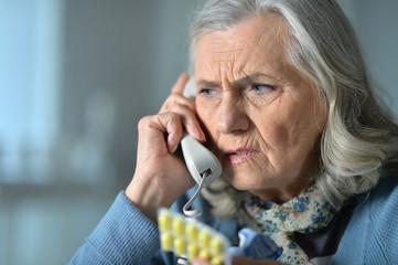 Close up portrait of upset senior woman