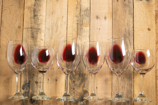 Flat lay red wine in glasses on wooden background with space, Concept of wine distillation, winery, winery, wine bar, party