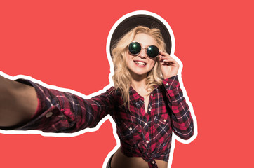 Collage portrait of a pretty girl in summer clothes taking a selfie isolated on red background