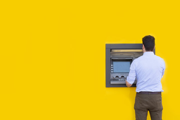 Man using a credit card in an atm for cash withdrawal Wall mural