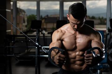 Muscular Man Exercising Chest