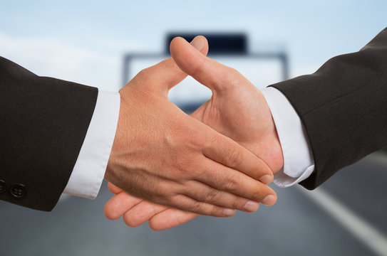Closeup of two businessmen shaking hands